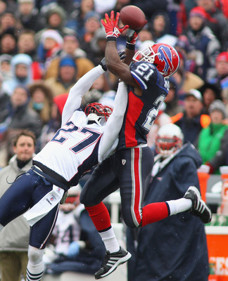 ORCHARD PARK, NY - DECEMBER 26:  C.J. Spiller #21 of the Buffalo Bills makes a catch against Kyle Arrington #27 of the New England Patriots at Ralph Wilson Stadium on December 26, 2010 in Orchard Park, New York. New England won 34-3. (Photo by Rick Stewar