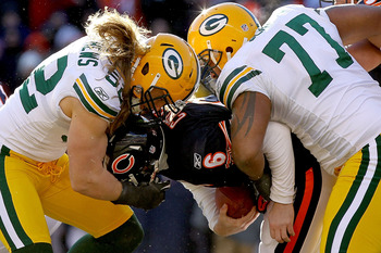 CHICAGO, IL - JANUARY 23:  Linebacker Clay Matthews #52 and Cullen Jenkins #77 of the Green Bay Packers sack quarterback Jay Cutler #6 of the Chicago Bears in the first half of the NFC Championship Game at Soldier Field on January 23, 2011 in Chicago, Ill