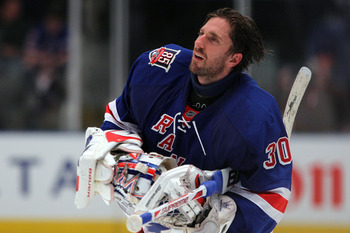 NEW YORK, NY - APRIL 20:  Goalie Henrik Lundqvist #30 of the New York Rangers skates towards the net with his helmet off against the Washington Capitals in Game Four of the Eastern Conference Quarterfinals during the 2011 NHL Stanley Cup Playoffs at Madis