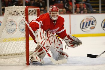 DETROIT - MARCH 5:  Dominik Hasek #39 of the Detroit Red Wings defends the net against the St. Louis Blues on March 5, 2008 at Joe Louis Arena in Detroit, Michigan. (Photo by Gregory Shamus/Getty Images)