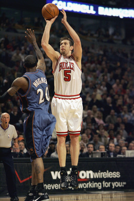 CHICAGO - APRIL 24: Andres Nocioni #5 of the Chicago Bulls takes a jump shot against Larry Hughes #20 of the Washington Wizards in game one of the Eastern Conference Quarterfinals  during the 2005 NBA Playoffs at the United Center on April 24, 2005 in Chi