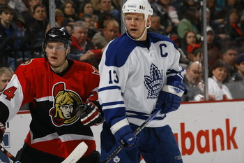 OTTAWA, CANADA - MARCH 8:   Anton Volchenkov #24 of the Ottawa Senators and Mats Sundin #13 of the Toronto Maple Leafs eye the play on March 8, 2007 at the Scotiabank Place in Ottawa, Canada. The Senators won 5-1.  (Photo by Phillip MacCallum/Getty Images