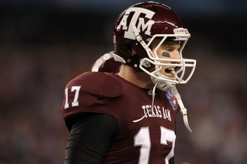 ARLINGTON, TX - JANUARY 07:  Quarterback Ryan Tannehill #17 of the Texas A&amp;M Aggies reacts after throwing a pass interception against the LSU Tigers during the AT&amp;T Cotton Bowl at Cowboys Stadium on January 7, 2011 in Arlington, Texas.  (Photo by Ronald M
