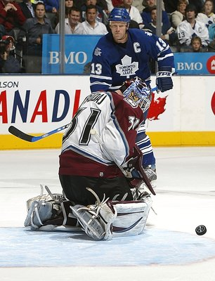 TORONTO - OCTOBER 18:  Mats Sundin #13 of the Toronto Maple Leafs looks on as Peter Budaj #31 of the Colorado Avalanche makes a save on October 18, 2006 at the Air Canada Centre in Toronto, Ontario, Canada.  (Photo by Dave Sandford/Getty Images)