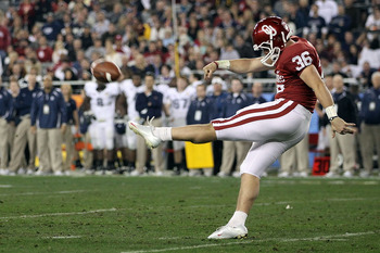 GLENDALE, AZ - JANUARY 01:  Tress Way #36 of the Oklahoma Sooners punts against the Connecticut Huskies during the Tostitos Fiesta Bowl at the Universtity of Phoenix Stadium on January 1, 2011 in Glendale, Arizona.  (Photo by Christian Petersen/Getty Imag