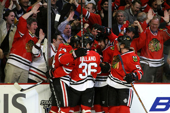 CHICAGO - APRIL 16:  (L-R) Martin Havlat #24, Dave Bolland #36, Cameron Barker #25 and Brian Campbell #51 of the Chicago Blackhawks celebrate along with their fans after Havlat scored a goal in the third period to tie the game 2-2 against the Calgary Flam