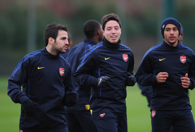 ST ALBANS, ENGLAND - FEBRUARY 15:  Cesc Fabregas, Samir Nasri and Theo Walcott of Arsenal warm-up during training at London Colney on February 15, 2011 in St Albans, England.  (Photo by Shaun Botterill/Getty Images)