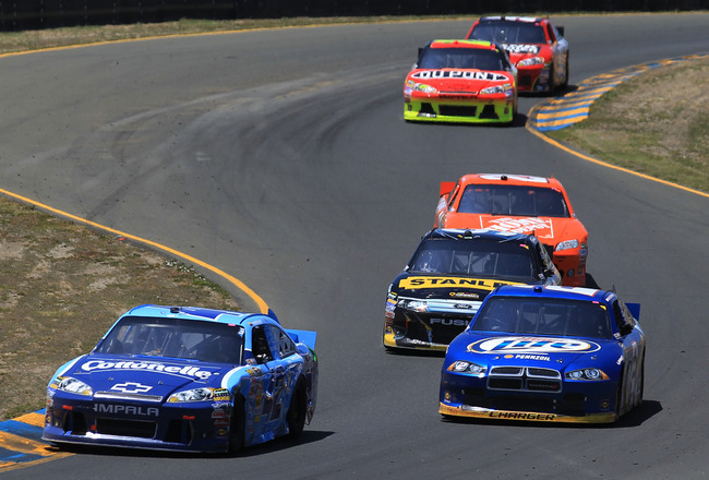 SONOMA, CA - JUNE 26:  Juan Pablo Montoya, driver of the #42 Cottonelle Chevrolet, races Brad Keselowski, driver of the #2 Miller Lite Dodge, during the NASCAR Sprint Cup Series Toyota/Save Mart 350 at Infineon Raceway on June 26, 2011 in Sonoma, Californ