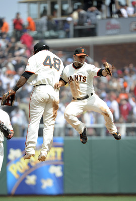 SAN FRANCISCO, CA - AUGUST 7: Pablo Sandoval #48 and Andres Torres #56 of the San Francisco Giants celebrates defeating the Philadelphia Phillies 3 to1  during an MLB baseball game at AT&T Park August 7, 2011 in San Francisco, California. (Photo by Thearo
