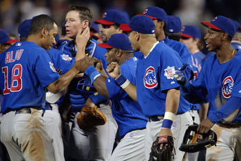 ATLANTA - OCTOBER 5:  Moises Alou #18 of the Chicago Cubs gets high fives from his teamates after the victory over the Atlanta Braves in game five of their National League Division Series on October 5, 2003 at Turner Field in Atlanta, Georgia.  The Cubs d
