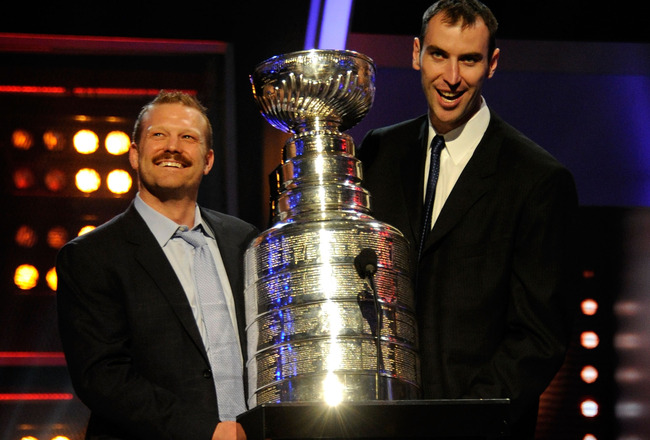 LAS VEGAS, NV - JUNE 22:  (L-R) Tim Thomas and Zdeno Chara of the Boston Bruins hold the Stanley Cup during the 2011 NHL Awards at The Pearl concert theater at the Palms Casino Resort June 22, 2011 in Las Vegas, Nevada.  (Photo by Ethan Miller/Getty Image