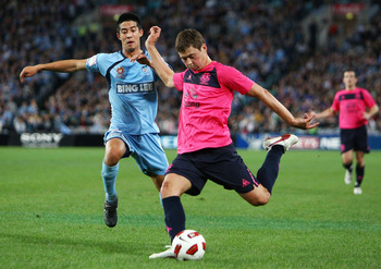 SYDNEY, AUSTRALIA - JULY 10:  Brendan Gan of Sydney attempts to tackle Diniyar Bilyaletdinov of Everton during a pre-season friendly match between Sydney FC and Everton FC at ANZ Stadium on July 10, 2010 in Sydney, Australia.  (Photo by Mark Nolan/Getty I