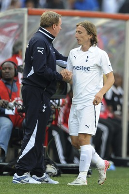 JOHANNESBURG, SOUTH AFRICA - JULY 23:  Manager Harry Redknapp greets Luka Modric of Tottenham during the 2011 Vodacom Challenge final match between Orlando Pirates and Tottenham Hotspur at Coca Cola Stadium on July 23, 2011 in Johannesburg, South Africa.