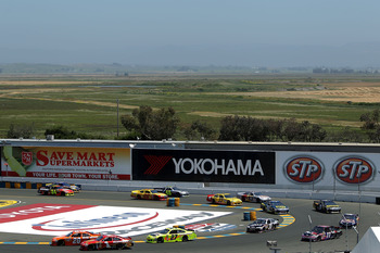 SONOMA, CA - JUNE 26:  Joey Logano, driver of the #20 The Home Depot Toyota, leads a group of cars during the NASCAR Sprint Cup Series Toyota/Save Mart 350 at Infineon Raceway on June 26, 2011 in Sonoma, California.  (Photo by Justin Edmonds/Getty Images
