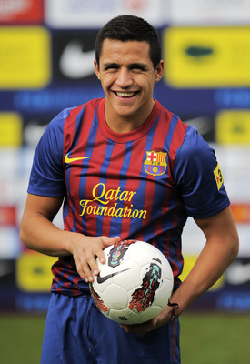 BARCELONA, SPAIN - JULY 25:  Alexis Sanchez from Chile poses during his presentation as the new signing for FC Barcelona at the Joan Gamper training camp sports complex on July 25, 2011 in Barcelona, Spain.  (Photo by David Ramos/Getty Images)