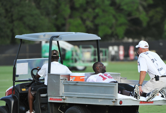 TAMPA, FL - JULY 29:  Wide receiver Mike Williams #19 of the Tampa Bay Buccaneers leaves the field after an injury during the team's first pre-season training camp practice July 29, 2011 at One Buccaneer Place in Tampa, Florida. (Photo by Al Messerschmidt