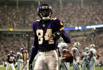 MINNEAPOLIS - SEPTEMBER 12:  Wide receiver Randy Moss #84 of the Minnesota Vikings looks up into the crowd after scoring a touchdown against the Dallas Cowboys on September 12, 2004 at Hubert H. Humphrey Metrodome in Minneapolis, Minnesota. The Vikings wo