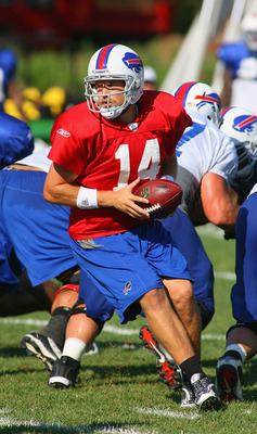 PITTSFORD, NY - AUGUST 08: Ryan Fitzpatrick #14 of the Buffalo Bills looks to hand off during Buffalo Bills Training Camp at St. John Fisher College on August 8, 2011 in Pittsford, New York.  (Photo by Rick Stewart/Getty Images)