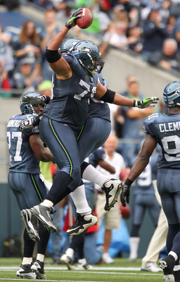 SEATTLE - SEPTEMBER 26:  Defensive end Red Bryant #79 of the Seattle Seahawks celebrates after recovering a fumble against the San Diego Chargers at Qwest Field on September 26, 2010 in Seattle, Washington. (Photo by Otto Greule Jr/Getty Images)