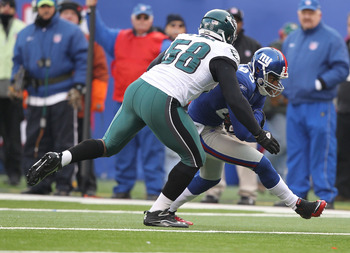 EAST RUTHERFORD, NJ - DECEMBER 19:  Derek Hagan #85 of the New York Giants runs against Trent Cole #58 of the Philadelphia Eagles during their game on December 19, 2010 at The New Meadowlands Stadium in East Rutherford, New Jersey.  (Photo by Al Bello/Get
