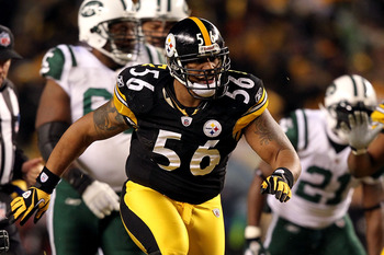 PITTSBURGH, PA - JANUARY 23:  LaMarr Woodley #56 of the Pittsburgh Steelers reacts after a sack against the New York Jets during the 2011 AFC Championship game at Heinz Field on January 23, 2011 in Pittsburgh, Pennsylvania. The Steelers won 24-19. (Photo