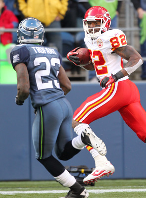 SEATTLE, WA - NOVEMBER 28:  Wide receiver Dwayne Bowe #82 of the Kansas City Chiefs rushes past Marcus Trufant #23 of the Seattle Seahawks for a touchdown and a 20-7 lead at Qwest Field on November 28, 2010 in Seattle, Washington. The Chiefs defeated the