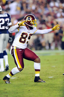 LANDOVER, MD - AUGUST 28:  Santana Moss #89 of the Washington Redskins celebrates after a first down during a preseason game against the New England Patriots at FedExField on August 28, 2009 in Landover, Maryland.  (Photo by Greg Fiume/Getty Images)