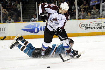 SAN JOSE, CA - MARCH 1: Douglas Murray #3 of the San Jose Sharks makes a diving save on the shot of Ryan Wilson #44 of the Colorado Avalanche in overtime during an NHL hockey game at the HP Pavilion on March 1, 2011 in San Jose, California. The Sharks won