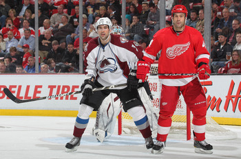 DETROIT,MI - NOVEMBER 13:  Todd Bertuzzi #44 of the Detroit Red Wings is watched by Ryan O'Byrne #3 of the Colorado Avalanche in a game on November 13,2010 at the Joe Louis Arena in Detroit, Michigan. The Wings defeated the Avalanche 3-1. (Photo by Claus