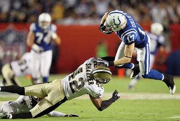 MIAMI GARDENS, FL - FEBRUARY 07:  Austin Collie #17 of the Indianapolis Colts is hit by Darren Sharper #42 of the New Orleans Saints during Super Bowl XLIV on February 7, 2010 at Sun Life Stadium in Miami Gardens, Florida.  (Photo by Andy Lyons/Getty Imag