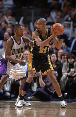 17 Feb 2000: Reggie Miller #31 of the Indiana Pacers looks to pass the ball as he is guarded by Ray Allen #34 of the Milwaukee Bucks of the at the Bradley Center in Milwaukee, Wisconson. The Pacers defeated the Bucks 92-90.