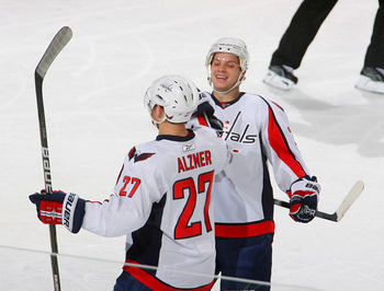 BUFFALO, NY - NOVEMBER 13: Karl Alzner #27 and John Carlson #74 of the Washington Capitals celebrate Alzner's goal in the first period against the Buffalo Sabres  at HSBC Arena on November 13, 2010 in Buffalo, New York.  (Photo by Rick Stewart/Getty Image