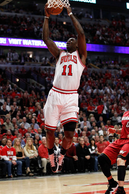 CHICAGO, IL - MAY 18:  Ronnie Brewer #11 of the Chicago Bulls drives for a shot attempt against the Miami Heat in Game Two of the Eastern Conference Finals during the 2011 NBA Playoffs on May 18, 2011 at the United Center in Chicago, Illinois. The Heat wo
