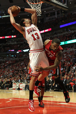 CHICAGO, IL - MAY 26:  Joakim Noah #13 of the Chicago Bulls attempts a shot against Udonis Haslem #40 of the Miami Heat in Game Five of the Eastern Conference Finals during the 2011 NBA Playoffs on May 26, 2011 at the United Center in Chicago, Illinois. N