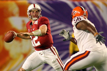 MIAMI, FL - JANUARY 03: Quarterback Andrew Luck #12 of the Stanford Cardinal looks to pass against Antoine Hopkins #56 of the Virginia Tech Hokies during the 2011 Discover Orange Bowl at Sun Life Stadium on January 3, 2011 in Miami, Florida. (Photo by Mar