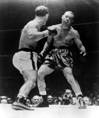 Rocky Marciano fighting the dusty old remains of Joe Louis