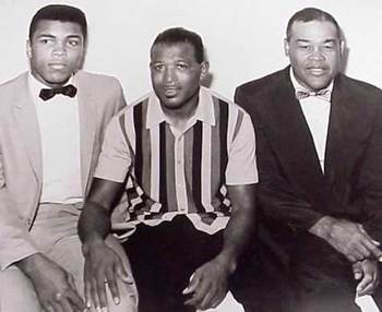 Muhamad Ali, pictured alongside the Greatest, Ray Robinson and fellow heavyweight legend Joe Louis,