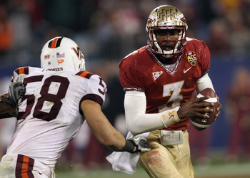 CHARLOTTE, NC - DECEMBER 04:  EJ Manuel #3 of the Florida State Seminoles runs away from Jack Tyler #58 of the Virginia Tech Hokies during their game at Bank of America Stadium on December 4, 2010 in Charlotte, North Carolina.  (Photo by Streeter Lecka/Ge