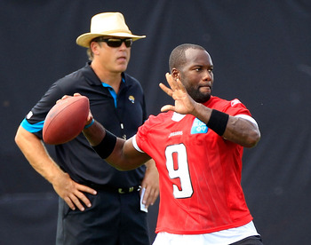 JACKSONVILLE, FL - JULY 28:  Quarterback David Garrard #9 of the Jacksonville Jaguars attempts a pass as coach Jack Del Rio looks on during training camp at Florida Blue Health and Wellness practice fields on July 28, 2011 in Jacksonville, Florida.  (Phot
