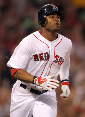 BOSTON, MA - AUGUST 01:  Carl Crawford #13 of the Boston Red Sox watches his solo home run in the third inning against the Cleveland Indians on August 1, 2011 at Fenway Park in Boston, Massachusetts.  (Photo by Elsa/Getty Images)