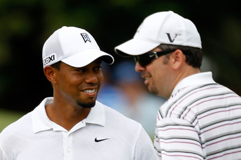 JOHNS CREEK, GA - AUGUST 09: (L-R) Tiger Woods and caddie Byron Bell look on during a practice round prior to the start of the 93rd PGA Championship at the Atlanta Athletic Club on August 9, 2011 in Johns Creek, Georgia.  (Photo by Mike Ehrmann/Getty Imag