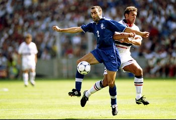 27 Jun 1998:   Giuseppe Bergomi of Italy holds off Havard Flo of Norway during the World Cup second round match at the Stade Velodrome in Marseille, France. Italy won 1-0. \ Mandatory Credit: Ben Radford /Allsport