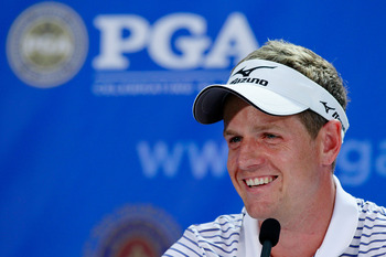 JOHNS CREEK, GA - AUGUST 09:  Luke Donald of England speaks to the media at a press conference during a practice round prior to the start of the 93rd PGA Championship at the Atlanta Athletic Club on August 9, 2011 in Johns Creek, Georgia.  (Photo by Scott