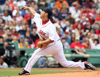 BOSTON, MA - MAY 08: Daisuke Matsuzaka #18 of the Boston Red Sox delivers a pitch in the first inning against the Minnesota Twins on May 8, 2011 at Fenway Park in Boston, Massachusetts.  (Photo by Elsa/Getty Images)