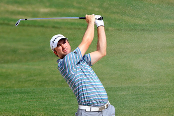 JOHNS CREEK, GA - AUGUST 09:   Martin Laird of Scotland hits a shot during a practice round prior to the start of the 93rd PGA Championship at the Atlanta Athletic Club on August 9, 2011 in Johns Creek, Georgia.  (Photo by Sam Greenwood/Getty Images)