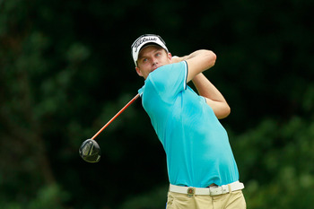 JOHNS CREEK, GA - AUGUST 09:  Nick Watney watches a shot during a practice round prior to the start of the 93rd PGA Championship at the Atlanta Athletic Club on August 9, 2011 in Johns Creek, Georgia.  (Photo by Kevin C. Cox/Getty Images)