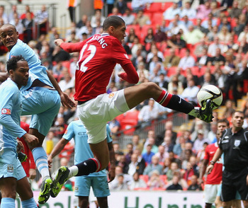LONDON, ENGLAND - AUGUST 07:  Chris Smalling of Manchester United scores his side's first goal during the FA Community Shield match sponsored by McDonald's between Manchester City and Manchester United at Wembley Stadium on August 7, 2011 in London, Engla
