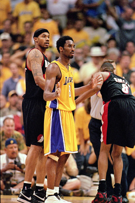 LOS ANGELES - JUNE 4:  Kobe Bryant #8 of the Los Angeles Lakers waits for the next play between Rasheed Wallace #30 and Steve Smith #8 of the Portland Trail Blazers during Game 7 of the Western Conference Finals at Staples Center on June 4, 2000 in Los An