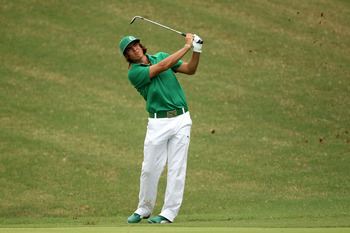 JOHNS CREEK, GA - AUGUST 09:  Rickie Fowler watches a shot during a practice round prior to the start of the 93rd PGA Championship at the Atlanta Athletic Club on August 9, 2011 in Johns Creek, Georgia.  (Photo by Andrew Redington/Getty Images)
