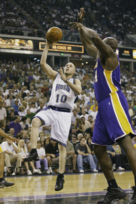 SACRAMENTO, CA - JUNE 2:  Mike Bibby #10 of the Sacramento Kings shoots over Shaquille O'Neal #34 of the Los Angeles Lakers in Game seven of the Western Conference Finals during the 2002 NBA Playoffs at Arco Arena in Sacramento, California on June 2, 2002
